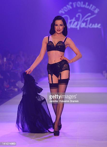 Dita Van Teese showcases designs by Von Folies by Dita Von Teese on the runway during L'Oreal Melbourne Fashion Festival on March 10 2012 in...