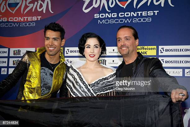 Dita von Teese Alex Christensen and Oscar Loya attend the press conference for Germany's team as she will be performing as a dancer The Final of the...