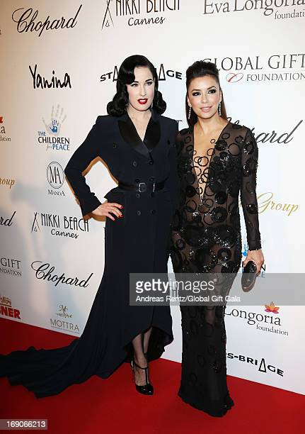 Dita Von Teese and actress Eva Longoria attends the 'Global Gift Gala' 2013 presented by Eva Longoria at Carlton Hotel on May 19, 2013 in Cannes,...
