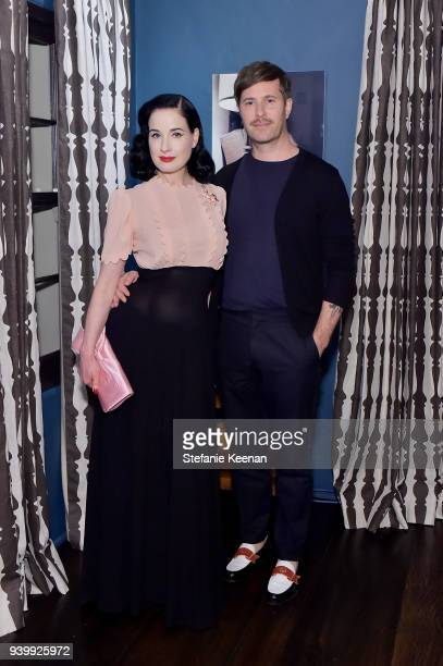 Dita Von Teese and Adam Rajcevich attend a private dinner to celebrate the One Year Anniversary of Beboe hosted by Lake Bell Lisa Eisner Assia...