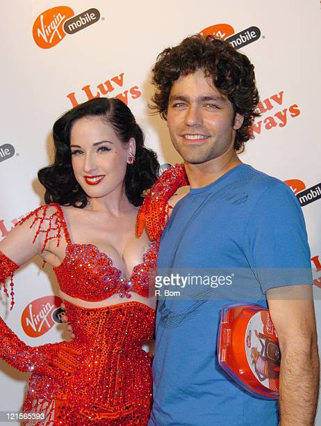 Dita Von Teese and Adrian Grenier during Virgin Mobile Presents 3 Ways To Pay As You Go at Sky Studio in New York City New York United States