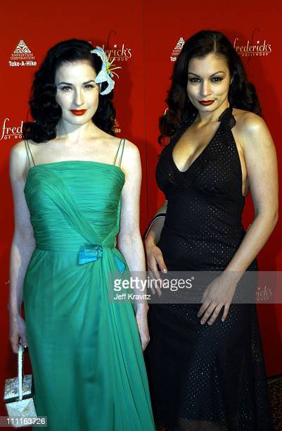 Dita Von Teese and Aria Giovanni during Frederick's of Hollywood Debuts Fall 2003 Collection at Smashbox Studios in Culver City, CA, United States.