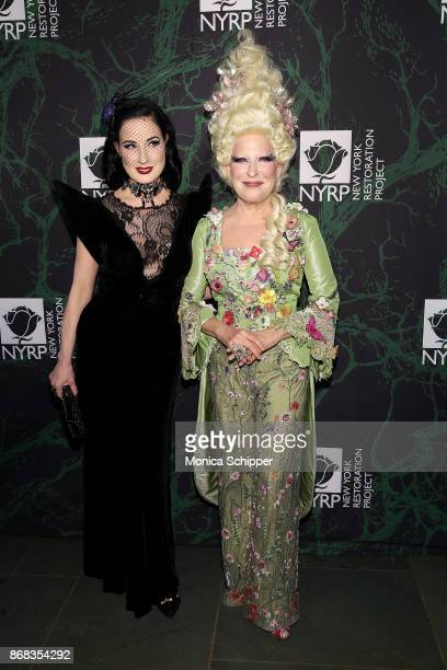Dita Von Teese and Bette Midler attend Bette Midler's 2017 Hulaween event benefiting the New York Restoration Project at Cathedral of St John the...