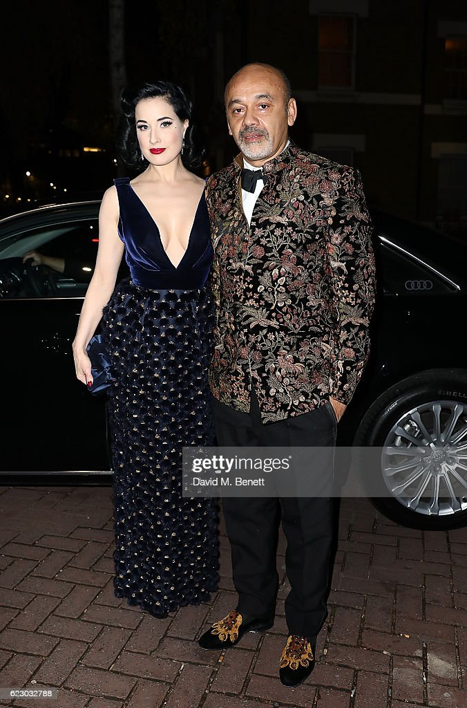 Dita Von Teese and Christian Louboutin arrive in an Audi at The London Evening Standard Theatre Awards at The Old Vic Theatre on November 13, 2016 in London, England.