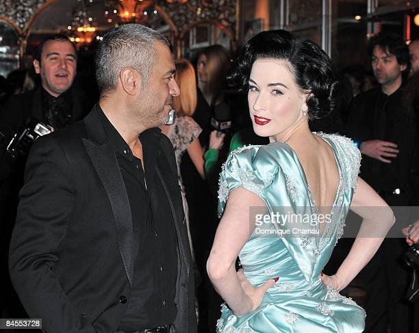 Dita Von Teese and Designer Elie Saab attend the Fashion Dinner for Aids at the Pavillon d'Armenonville on January 29 2009 in Paris France