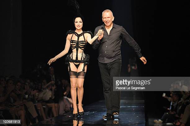 Dita Von Teese and designer JeanPaul Gaultier walk the runway during the JeanPaul Gaultier show as part of the Paris Haute Couture Fashion Week...