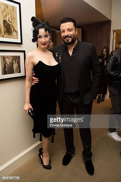 Dita Von Teese and designer Zuhair Murad attend the Zuhair Murad cocktail party at Sunset Tower Hotel on November 16 2016 in West Hollywood California
