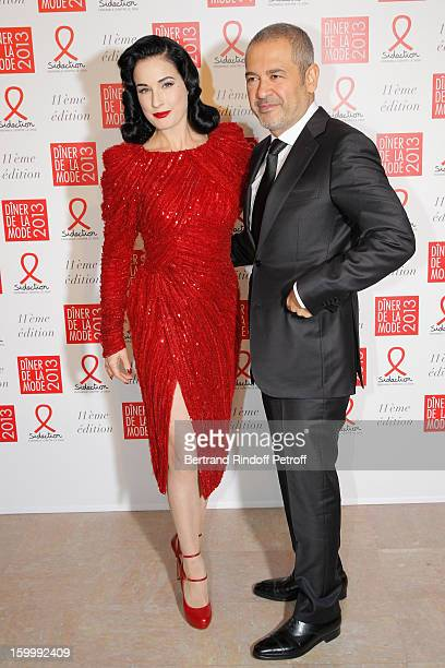 Dita Von Teese and Elie Saab pose as they arrive to attend the Sidaction Gala Dinner 2013 at Pavillon d'Armenonville on January 24 2013 in Paris...