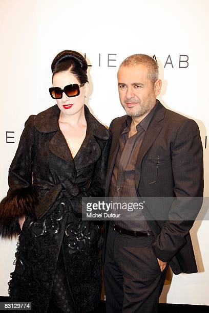 Dita von Teese and Elie Saab show attends the Elie Saab show during Paris Fashion Week at Le Carrousel du Louvre on October 4 2008 in Paris France