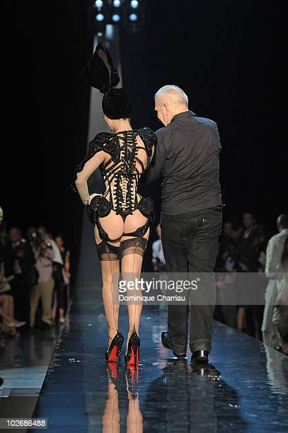 Dita Von Teese and Jean-Paul Gaultier walk the runway at the end of the Jean-Paul Gaultier show as part of the Paris Haute Couture Fashion Week...