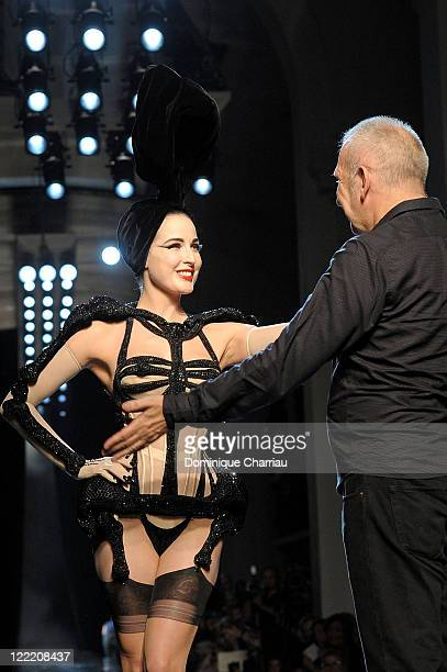 Dita Von Teese and JeanPaul Gaultier walk the runway at the end of the JeanPaul Gaultier show as part of the Paris Haute Couture Fashion Week...