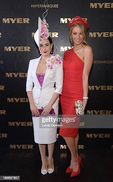 Dita Von Teese and Jennifer Hawkins attend the Myer marquee during Melbourne Cup Day at Flemington Racecourse on November 5 2013 in Melbourne...