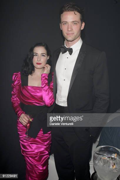 Dita Von Teese and Louis Marie de Castelbajac attend amfAR Milano 2009 After Party the Inaugural Milan Fashion Week event at La Permanente on...
