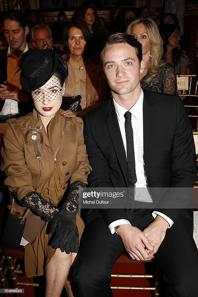 Dita von Teese and Louis Marie de Castelbajac attend the John Galliano Ready to Wear Spring/Summer 2011 show during Paris Fashion Week at Opera Comique on October 3, 2010 in Paris, France.