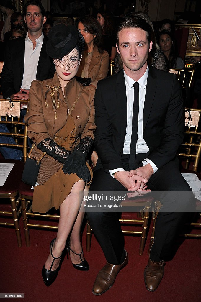Dita Von Teese and Louis-Marie de Castelbajac attend the John Galliano Ready to Wear Spring/Summer 2011 show during Paris Fashion Week at Opera Comique on October 3, 2010 in Paris, France.