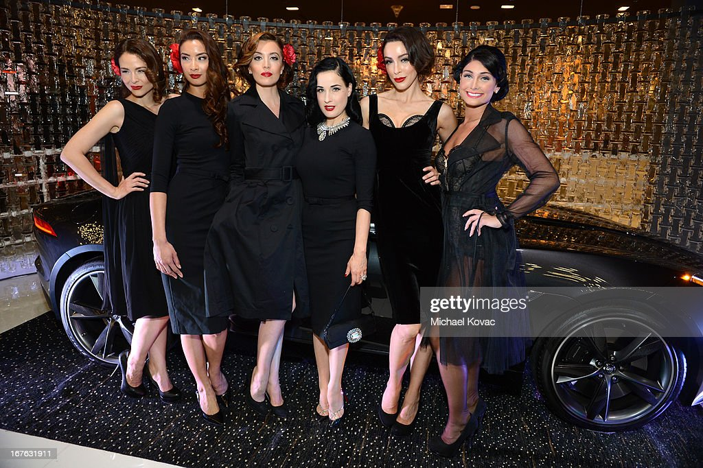 Dita Von Teese (C) and models pose for at the BritWeek Christopher Guy event with official vehicle sponsor Jaguar on April 26, 2013 in Los Angeles, California.