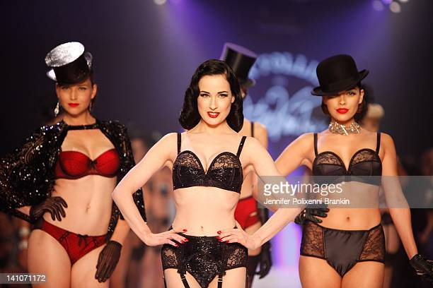 Dita Von Teese and models showcases designs by Von Folies by Dita Von Teese on the runway during L'Oreal Melbourne Fashion Festival on March 10 2012...
