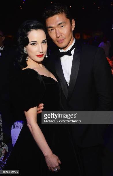 Dita Von Teese and Rick Yune attend amfAR's 20th Annual Cinema Against AIDS during The 66th Annual Cannes Film Festival at Hotel du CapEdenRoc on May...