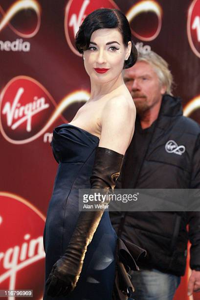 Dita Von Teese and Sir Richard Branson during Virgin Media Photocall at Covent Garden in London Great Britain