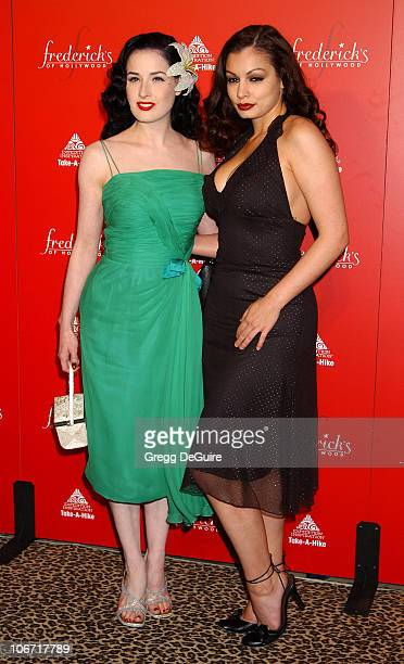 Dita Von Teese & Aria Giovanni during Smashbox Fashion Week Los Angeles - Frederick's of Hollywood Fashion Show Fall 2003 Collection to benefit...