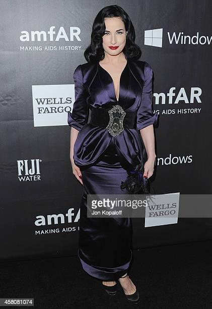 Dita Von Teese arrives at the 2014 amfAR LA Inspiration Gala at Milk Studios on October 29, 2014 in Hollywood, California.
