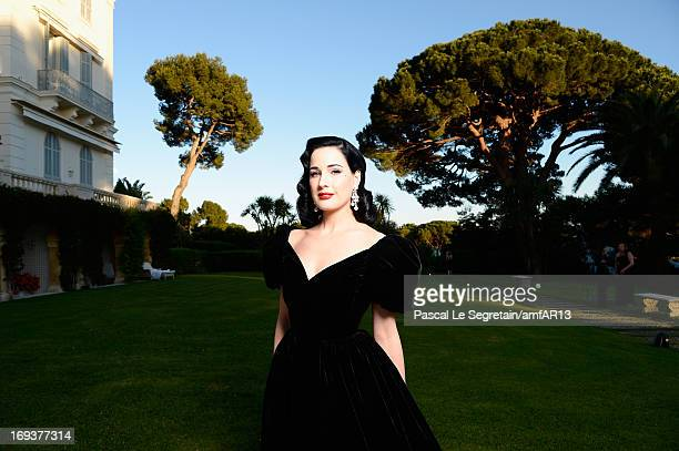 Dita von Teese attends amfAR's 20th Annual Cinema Against AIDS during The 66th Annual Cannes Film Festival at Hotel du Cap-Eden-Roc on May 23, 2013...
