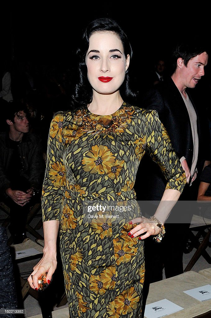 Dita Von Teese attends the Burberry Spring Summer 2013 Womenswear Show Front Row at Kensington Gardens on September 17, 2012 in London, England.