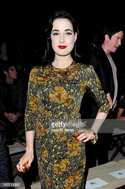 Dita Von Teese attends the Burberry Spring Summer 2013 Womenswear Show Front Row at Kensington Gardens on September 17 2012 in London England