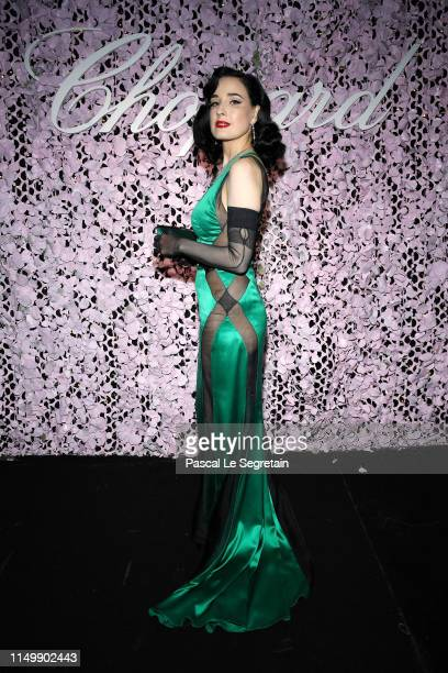 Dita Von Teese attends the Chopard Love Night dinner on May 17, 2019 in Cannes, France.