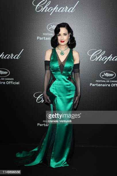 Dita Von Teese attends the Chopard Love Night photocall on May 17 2019 in Cannes France