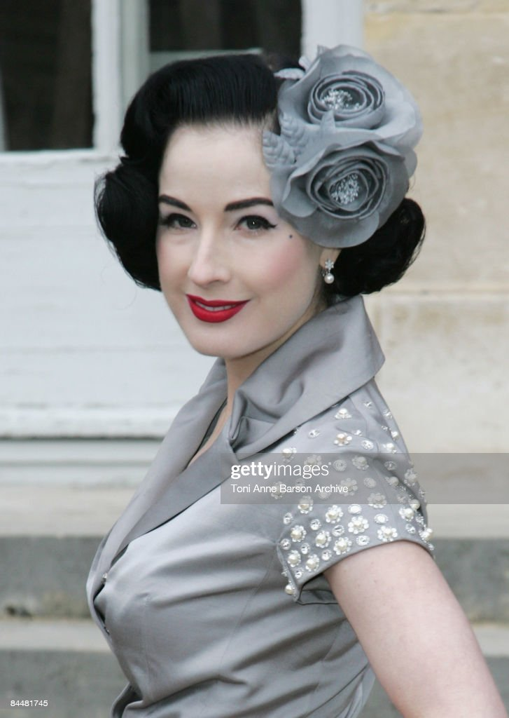 Dita Von Teese attends the Christian Dior fashion show during Paris Haute Couture Fashion Week Spring/Summer 2009 at Musee Rodin on January 26, 2009 in Paris, France.