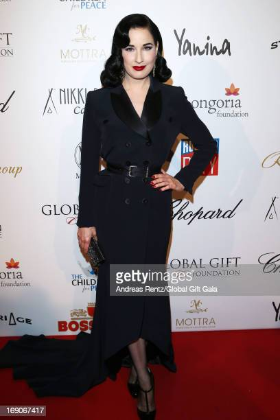 Dita Von Teese attends the 'Global Gift Gala' 2013 presented by Eva Longoria at Carlton Hotel on May 19, 2013 in Cannes, France.