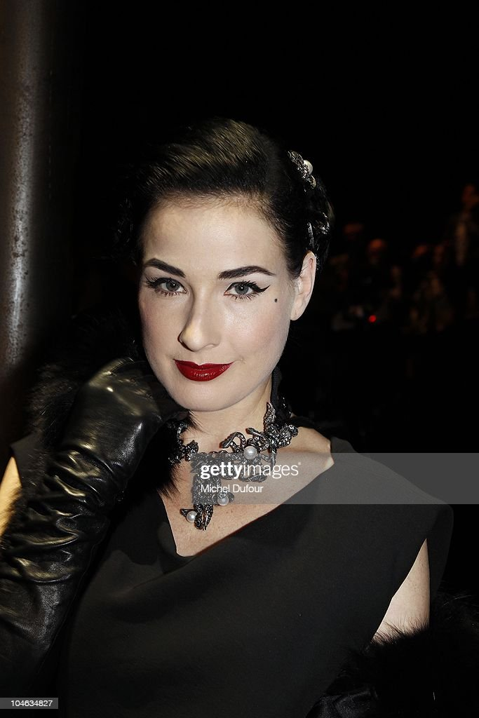 Dita von Teese attends the Lanvin Ready to Wear Spring/Summer 2011 show during Paris Fashion Week at Halle Freyssinet on October 1, 2010 in Paris, France.