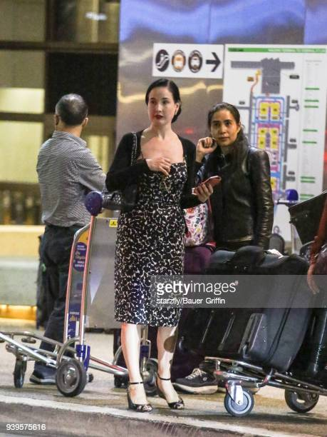 Dita Von Teese is seen at Los Angeles International Airport on March 28 2018 in Los Angeles California