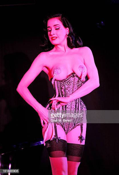 Dita Von Teese performs at a performance by Dita Von Teese at The Arts Club on September 9 2012 in London England