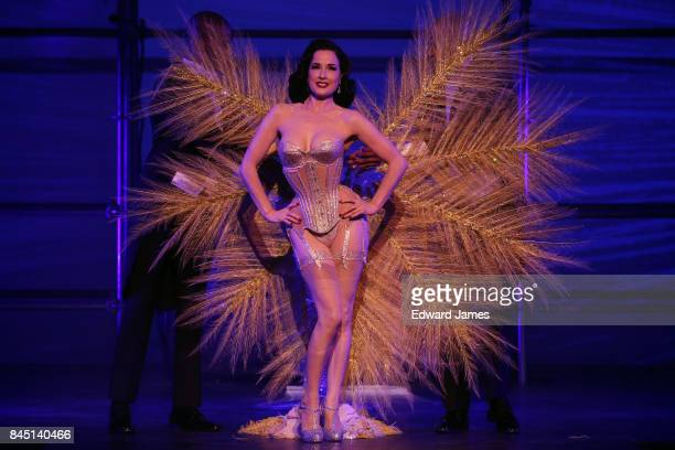 Dita von Teese performs at the Philipp Plein Spring/Summer 2018 collection fashion show during New York fashion week on September 9, 2017 in New York...