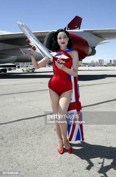 Dita Von Teese pose for photographers at McCarran International Airport Las Vegas USA to celebrate the 10th Anniversary of Virgin Atlantic flights to...