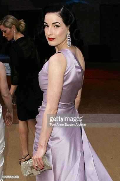 Dita Von Teese poses at the arrivals for the Dior Fall/Winter 2008 Fashion Show on July 2 in Versailles France