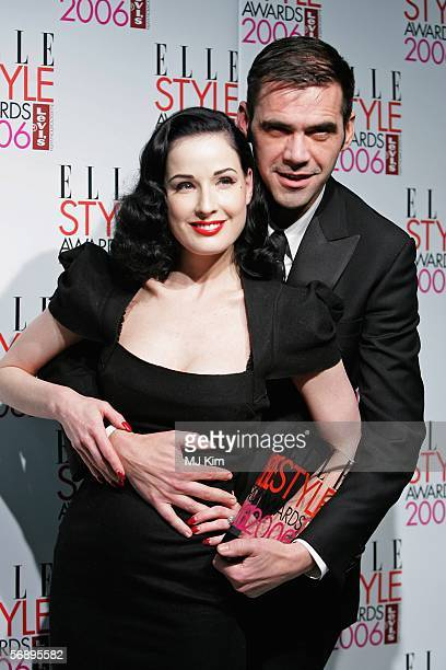 Dita Von Teese poses backstage with Roland Mouret winner of the International Designer Award at the ELLE Style Awards 2006 the fashion magazine's...