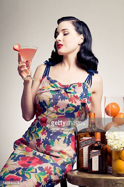 Dita Von Teese poses for a portrait at the Cointreau and Dita Von Teese Launch Summer Bar Cart Cocktail Program at Poolside Soiree on June 7 2012 at...
