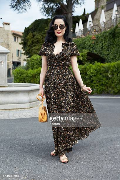 fd7ea4e59c85 Dita Von Teese poses on the street during the 68th annual Cannes Film  Festival on May