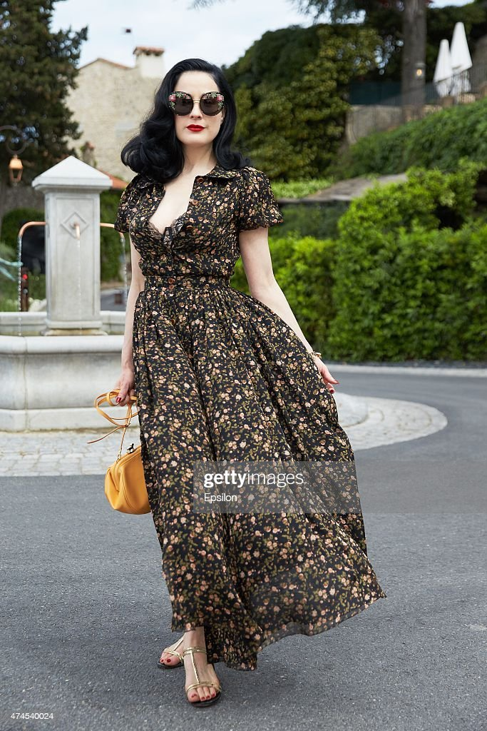 Dita Von Teese Poses At The Carlton Hotel - The 68th Annual Cannes Film Festival