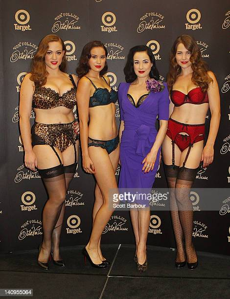 Dita Von Teese poses with models showcasing the Von Follies collection at the Von Follies by Dita Von Teese for Target photo call on March 9 2012 in...