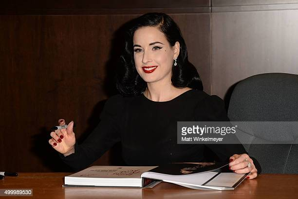 Dita Von Teese signs copies of her new book 'Your Beauty Mark The Ultimate Guide to Eccentric Glamour' at Barnes Noble at The Grove on December 4...