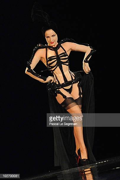 Dita Von Teese walks down the catwalk during the JeanPaul Gaultier's show as part of the Paris Haute Couture Fashion Week Fall/Winter 2011 on July 7...