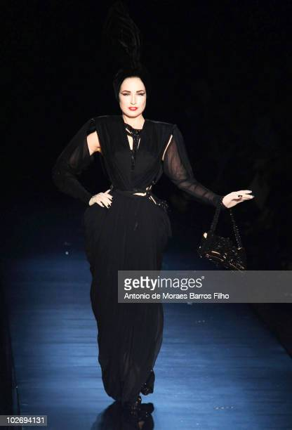 Dita Von Teese walks the runway at the Jean-Paul Gaultier show as part of the Paris Haute Couture Fashion Week Fall/Winter 2011 on July 7, 2010 in...