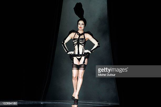 Dita von Teese walks the runway during the Jean Paul Gaultier fashion show as part of the Paris Haute Couture Fashion Week Fall/Winter 2011 at on...
