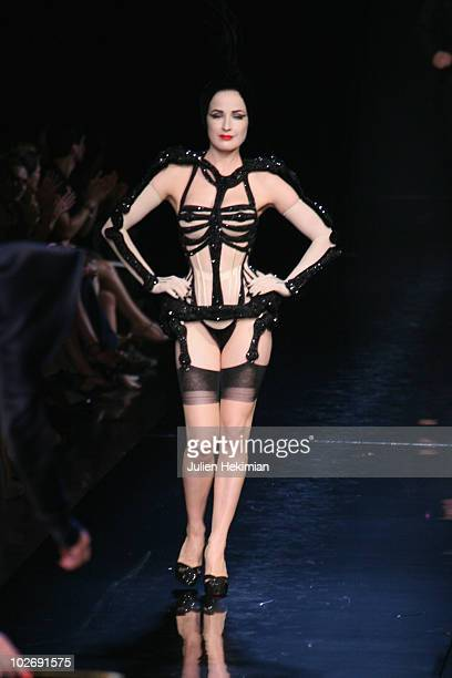 Dita Von Teese walks the runway during the JeanPaul Gaultier show as part of the Paris Haute Couture Fashion Week Fall/Winter 2011 on July 7 2010 in...