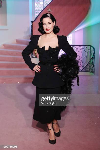 Dita von Teese walks the runway during the Ulyana Sergeenko Haute Couture Spring/Summer 2020 show as part of Paris Fashion Week on January 20, 2020...