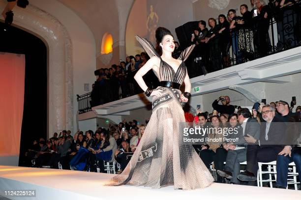 Dita von Teese walks the runway in front of Farida Khelfa Mademoiselle Agnes Boulard Emmanuelle Alt Owners of Gaultier Manuel Puig and his brother...